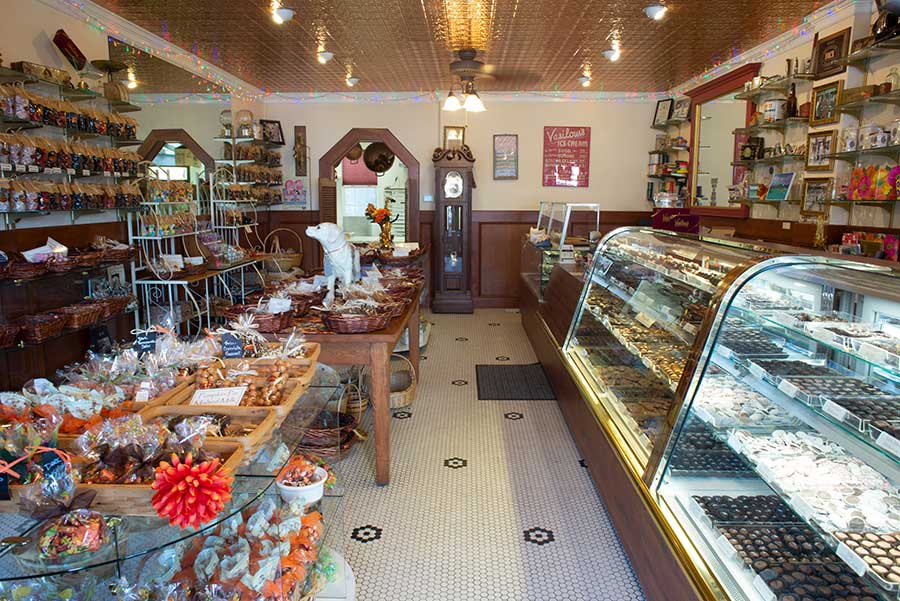 Interior of Vasilow's candy store showing candy showcase
